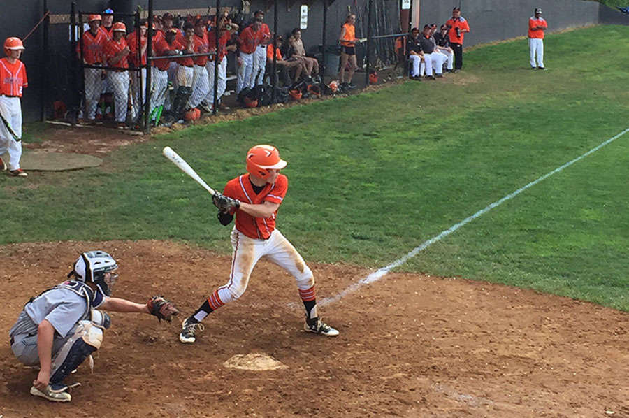 Junior Matt McTighe winds up to swing at incoming pitch during the sectional finals. McTighe was the starting pitcher for RHS, lasting three innings.