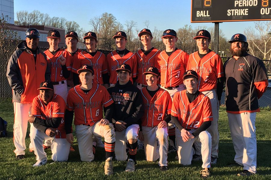 Top row on the left, coach Farron Riggs poses with the varsity baseball team after winning against Poolesville HS and becoming Division champs. Riggs has been coaching at RHS for the past 21 years.