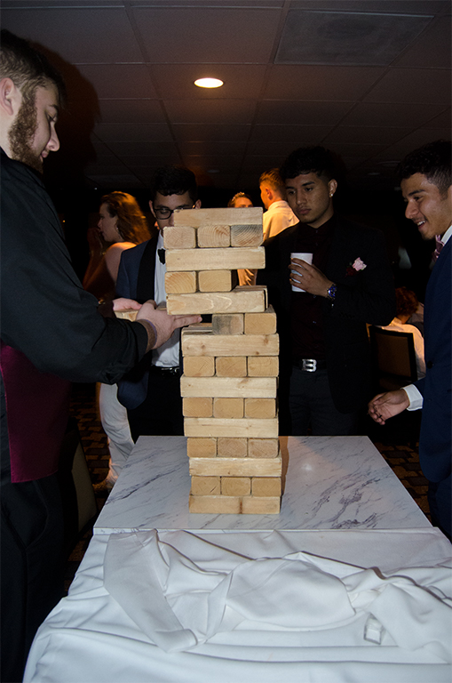 Students play jumbo jenga with the added difficulty of the boat rocking back and forth throughout the match.