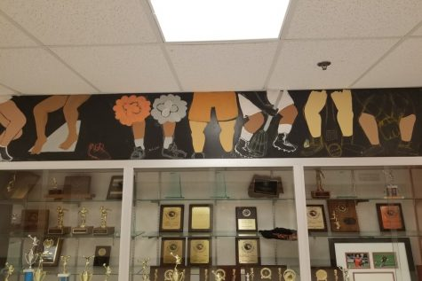 National Art Honor Society Designs, Paints Athlete Mural Over Trophy Case