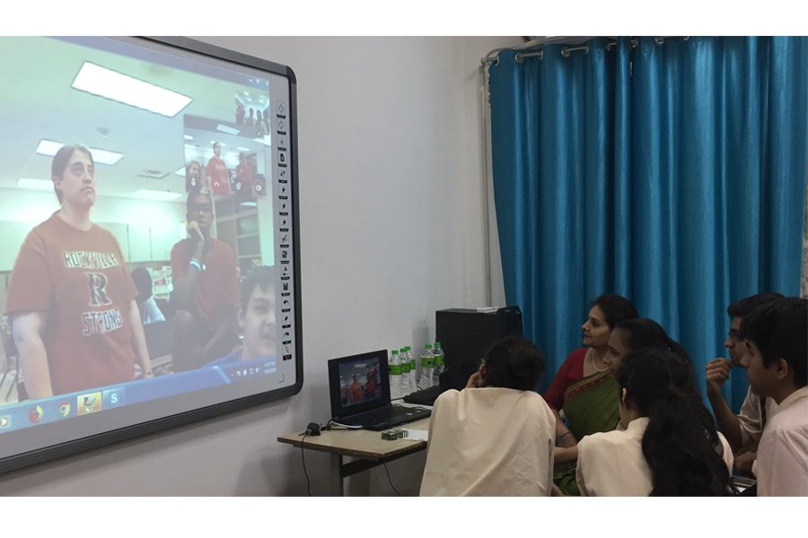 Sixteen-year-old students in India Skype call with students in history teacher Rene Shuler's NSL class.