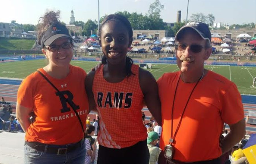 Wong (center) ran May 25 at the States Track Meet accompanied by both coaches and was the only RHS track athlete to compete.