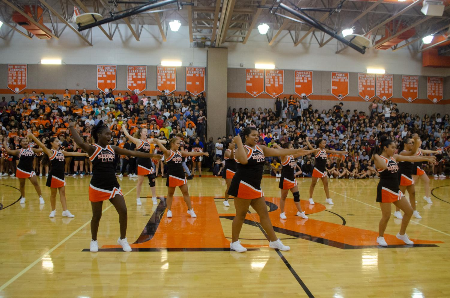 Cheer+performing+their+new+routine+at+the+fall+pep+rally.