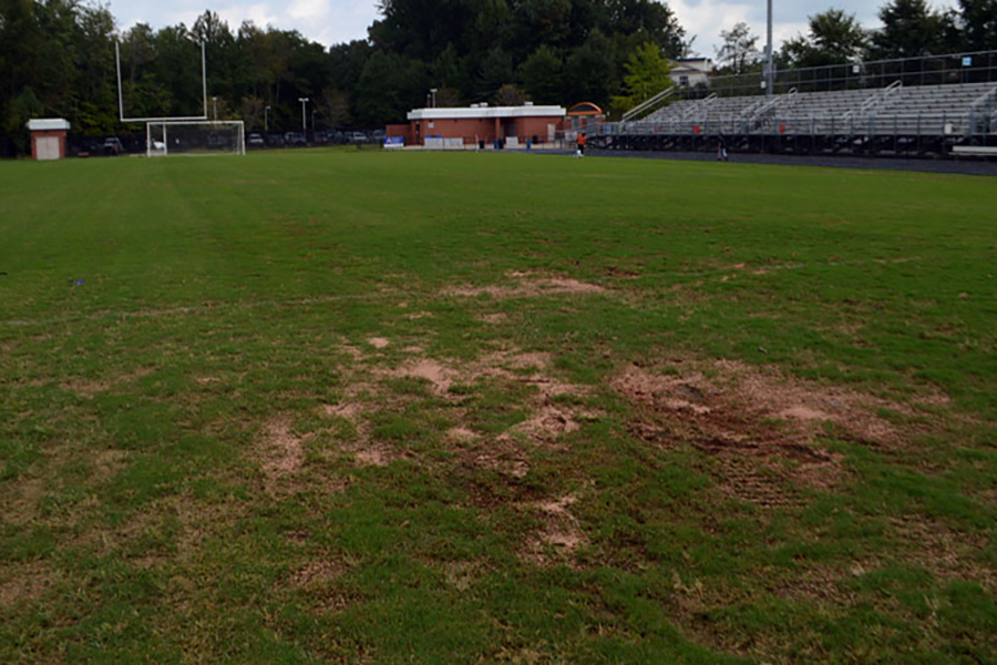 The new stadium field now has multiple dirt patches caused from recent flooding. The Bermuda grass was installed over the summer and was intended to be used for all fall sports games.