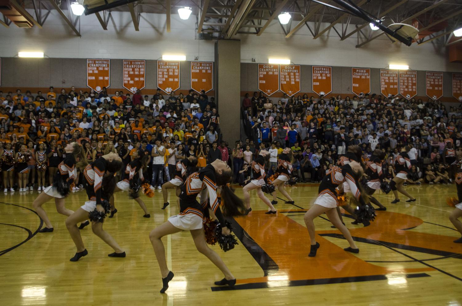 The+poms+team+performing+their+new+routine+for+the+student+body.+
