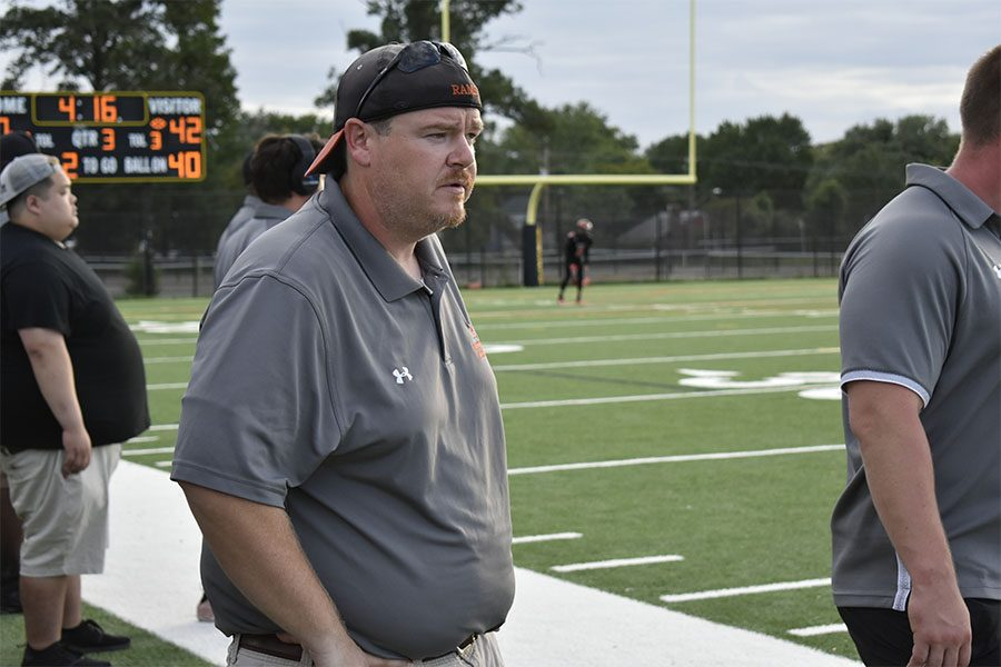 Head coach Jason Lomax surveys the field during the team's loss to the Damascus Hornets Sept. 15.