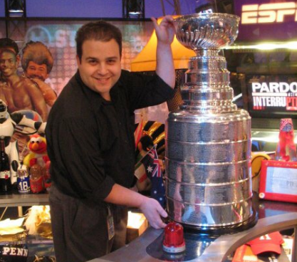 Media service technician Steve Mirman poses with the Stanley Cup while working for Comcast Sports Network, prior to working at RHS.