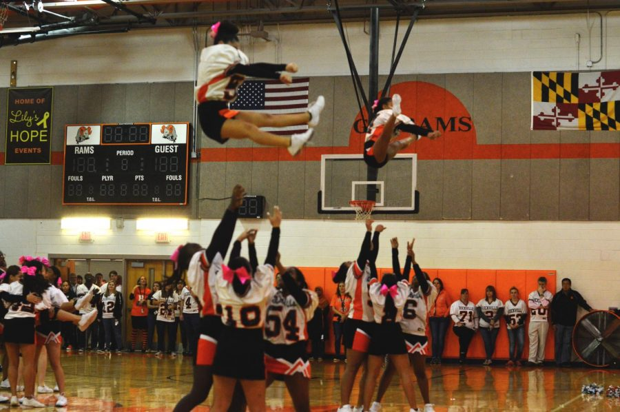 The cheer team performs stunts for the gymnasium of students.  That evening they performed with K-8 students who attended cheer camp at RHS earlier in the week.