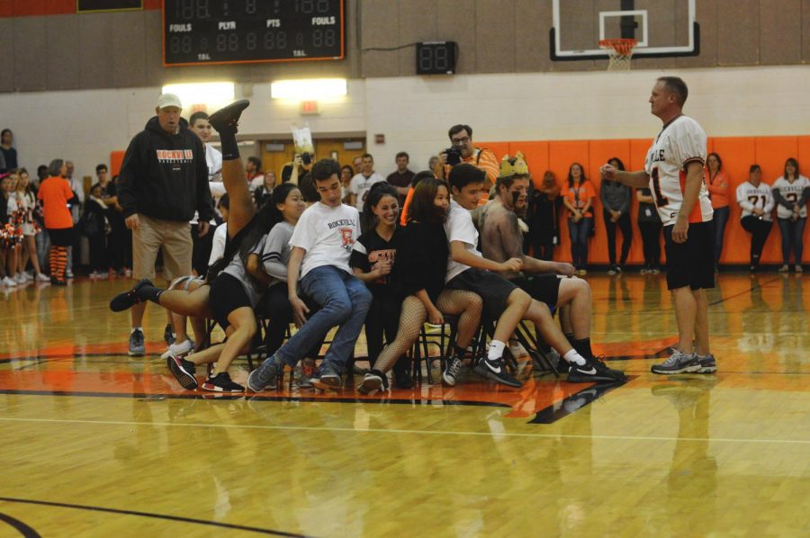 Students participate in a musical chairs game during the pep rally. Each class sent representatives for the last game of the homecoming class competitions, which the seniors won.