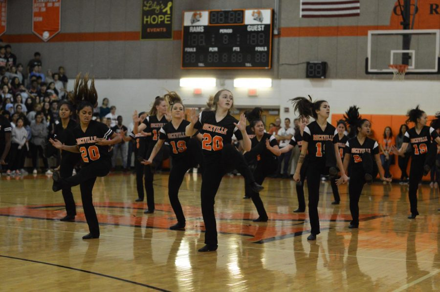 Poms perform their dance routine for the student body to build excitement for the homecoming football game.