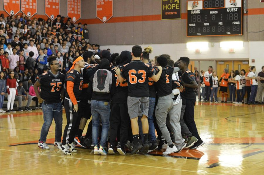 The varsity football team generates excitement for the homecoming football game that night against the Magruder Colonels.