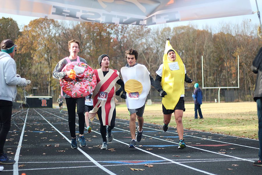 Juniors cross country runners Michael Carvajal, Joey Udovich, Dylan Kim, and Senior Howard Kirk dressed up as breakfast foods and linked arms to cross the finish line.