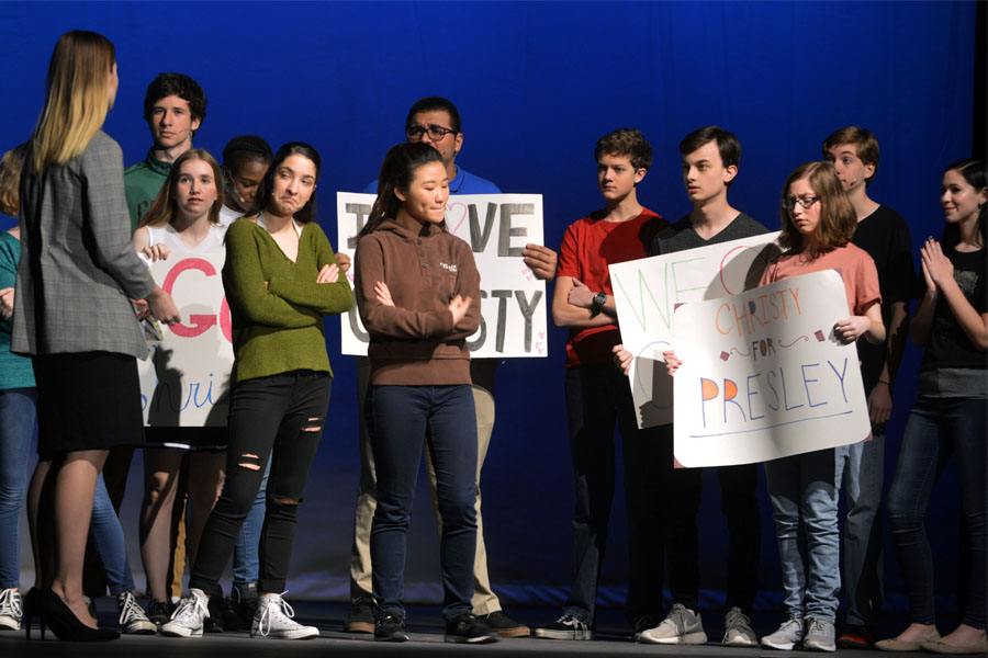 Actors portraying students speak to candidate Christy Martin. The play was performed Nov. 9, 10, 16 and 17.