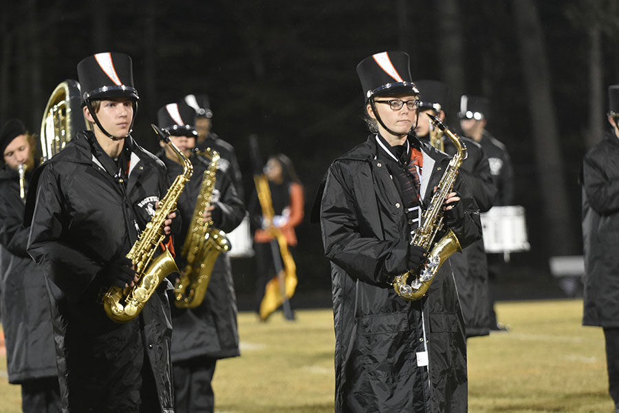 Members of the marching band perform during halftime at the varsity football senior night game against Richard Montgomery High School Oct. 26.