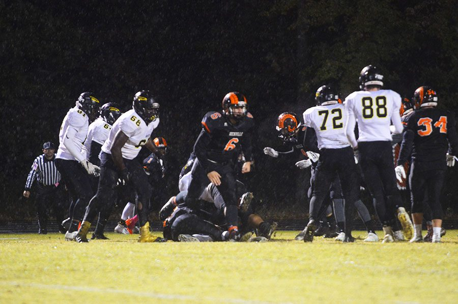 Sophomore Connor Pace (6) celebrating after the Rams make a tackle against the Richard Montgomery Rockets.