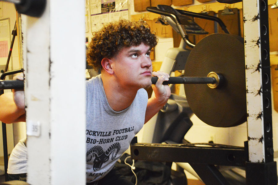 Sophomore Luke Hill works out in the weight room during the offseason.  He attended 96 percent of the offseason football workouts that began in January.