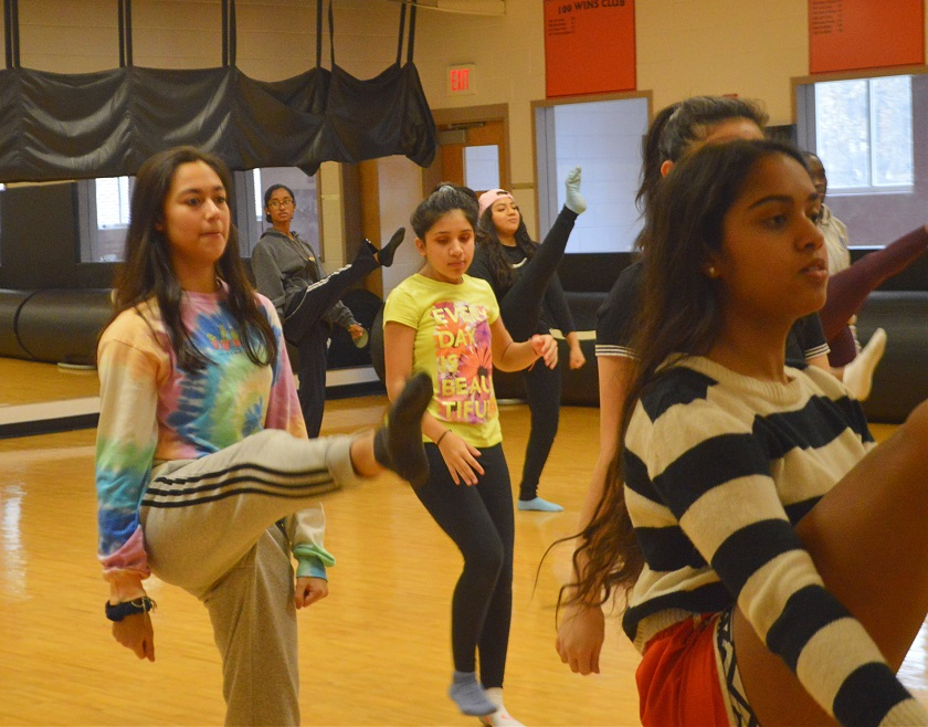 "Junior Ashley Gonsalves practices with classmates in dance teacher Debra Williams's fourth period dance class as they prepare for the end-of-the-year dance recital. ""The movements Ms. Williams teaches us, we put together into a choreography,"" Gonsalves said."