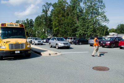 Security directs buses after school in the main parking lot.  Recently, MCPS reached out to county officials discussing ways to increase student and bus safety.