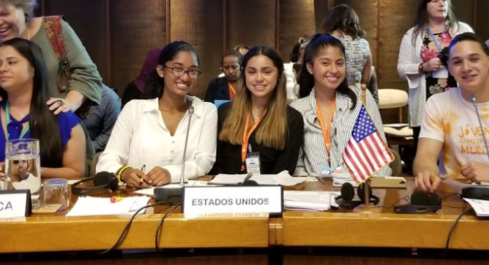 Suarez, Moreno-Canales and Estrada (left to right) presenting their project at the CEPAL headquarters in front of ambassadors.