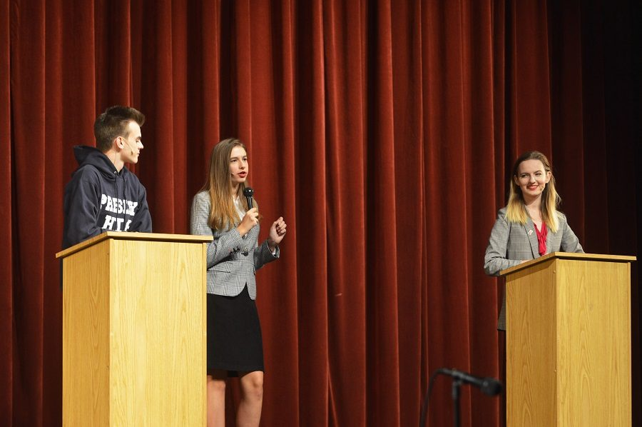 Students Mark Davenport played by junior Luke Marple and Christy Martin played by sophomore Mara Andrei Armasaru, compete for the title of student president at a mock debate.