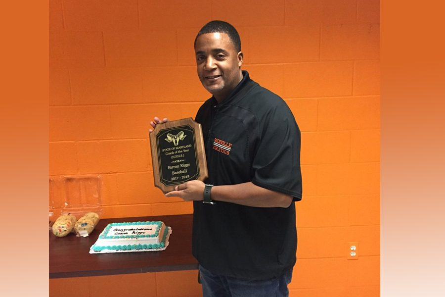 Baseball coach Farron Riggs holds a plaque honoring him as the Maryland baseball coach of the year. Riggs has been coaching for 21 years.