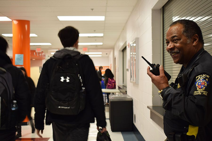 School Resource Officer, Arnold Aubrey watches as students pass by in the hallway during lunch. Aubrey has brought a new sense of safety and security to the school.