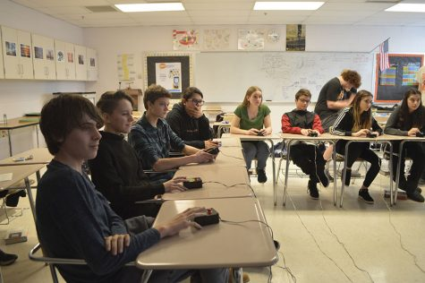 Students answer practice questions during the It's Academic practice using their buzzers.  The club's studio is being moved and team members expressed concern over losing their Giant Foods sponsorship.