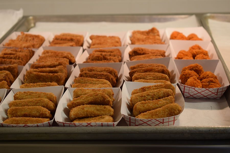 Mozzarella sticks laid out as one of a variety of lunch options for students.  Cafeteria managers are required to serve certain daily specials, though they have the flexibility to offer additional options.