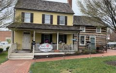 Sisters Sandwiches located in Olney is set in an historic log cabin style building.