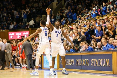 Duke guard RJ Barret and forward Zion Williamson celebrate during a timeout. NCAA players such as Williamson should allow their athletes to make money off their likeliness and sponsors.