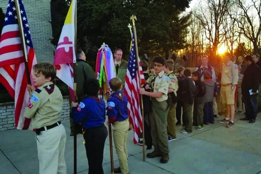 Scouts from Boy Scout Troop and Cub Scout Pack 457 wait to process as part of a ceremonial mass, held by their sponsoring organization, Saint Patrick's Church.