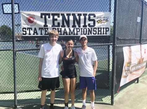 Pictured left to right: Senior Dennis Piliptchak, freshman Sania Suchinsky and junior Keeyan Mirzai celebrate May 25 after winning the tennis state championship.