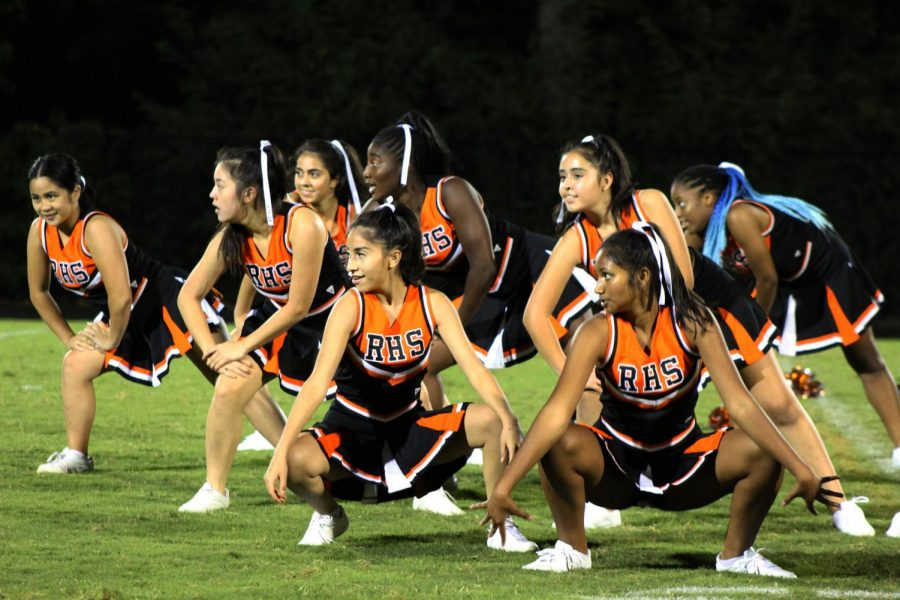 The poms team pose in formation during their halftime performance.