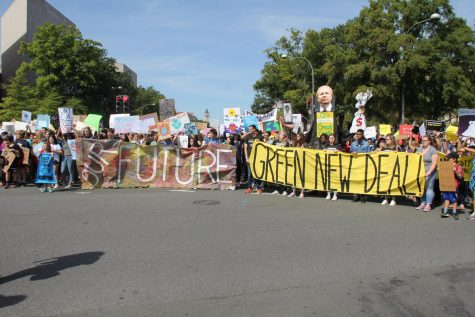 Protesters, a large portion of which are students, present their banners while enroute to Capitol Hill Sept. 20.