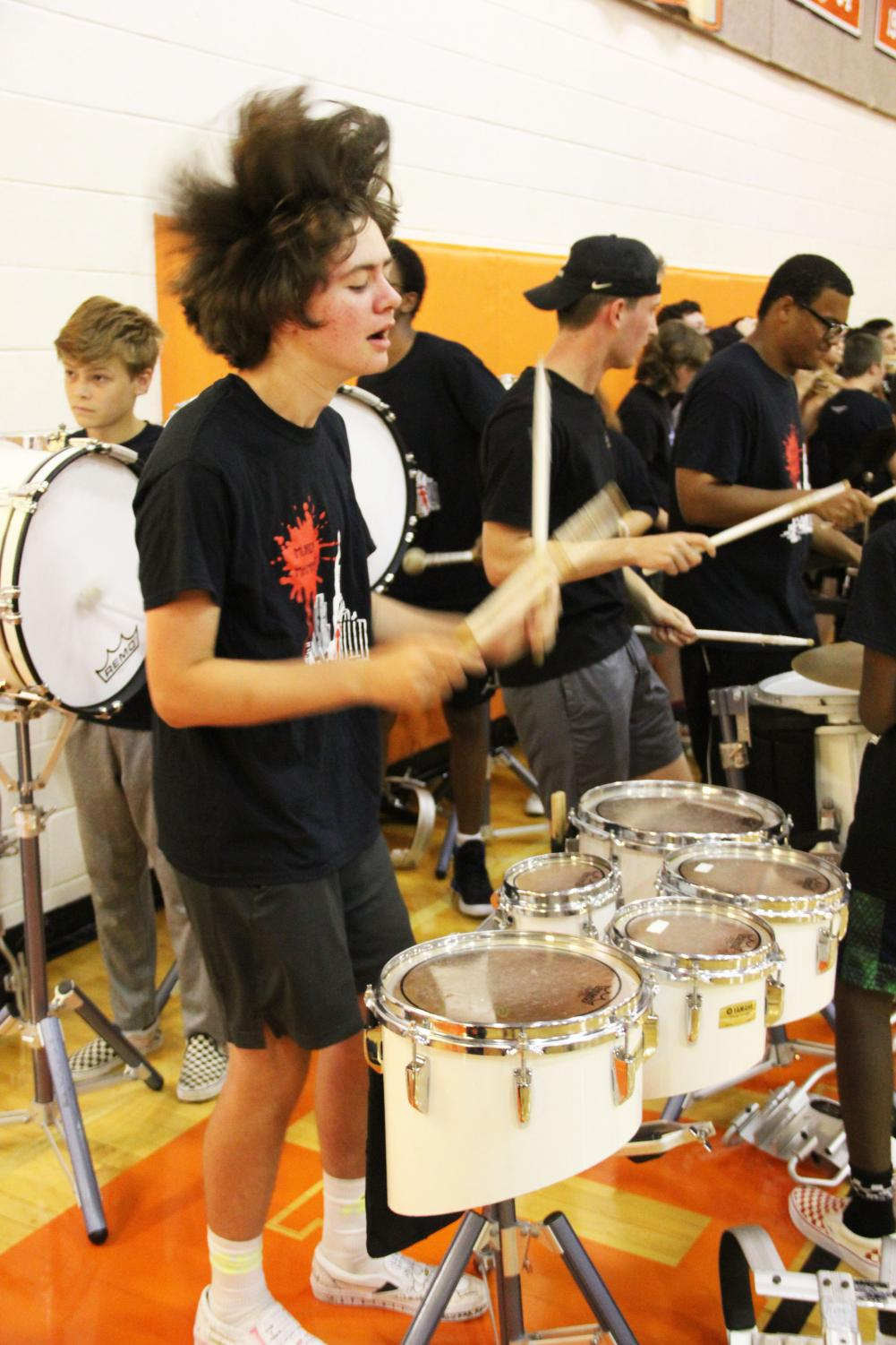 Sophomore+Lucas+Kirby+rocks+out+with+the+rest+of+the+RHS+drum+line.