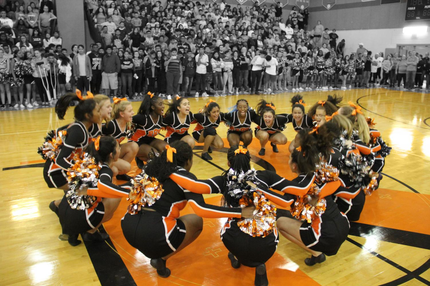 The+Poms+team+prepare+themselves+for+their+first+performance+of+the+school+year.+