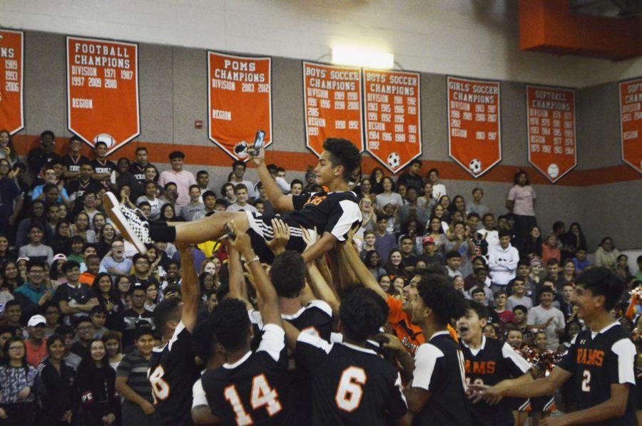 Senior Diego Navarro is lifted up by his boys varsity soccer teammates.