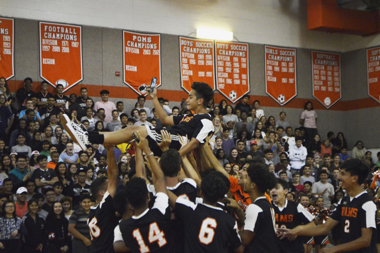 Senior+Diego+Navarro+is+lifted+up+by+his+boys+varsity+soccer+teammates.+