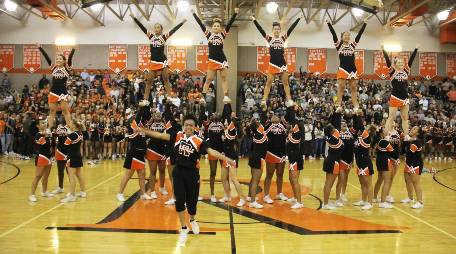 Varsity+cheer+pumps+up+the+crowd+during+their+performance.