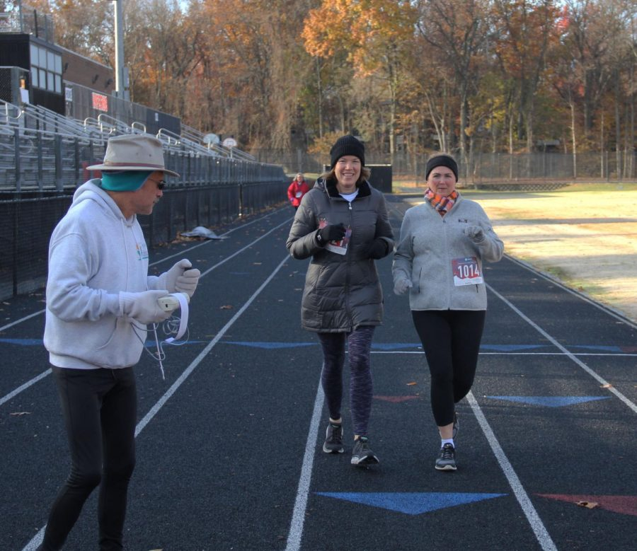 RHS parents Kari Barrett and Heather Poulin jog through the finish line after walking the majority of the course.
