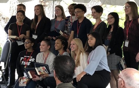 Each of the 13 Fitzgerald Scholars pose with their awards from the festival, which took place Oct. 12 at the Glenview Mansion.
