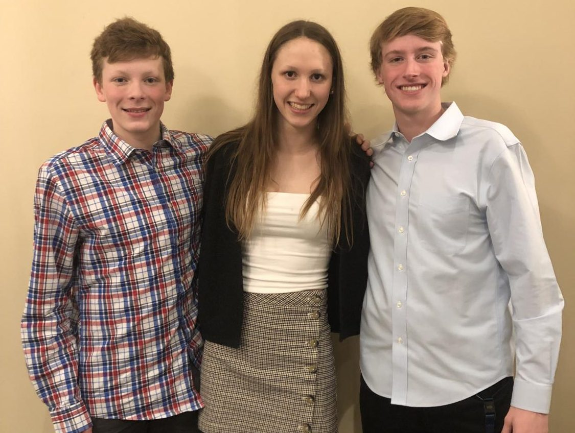 From left to right, freshman Toby Barnett won the 200 individual medley State championship and finished third in the 100 m backstroke. Sophomore Maeve Campbell placed third in the swim 100 m backstroke and fifth in the 100 m freestyle.   Junior Sean Davis won the 500 freestyle with a time of 4:41.03.