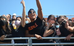 Students in the class of 2022 cheer during the first pep rally of the year. Despite the new outdoor venue, the spirit of the event remained the same.
