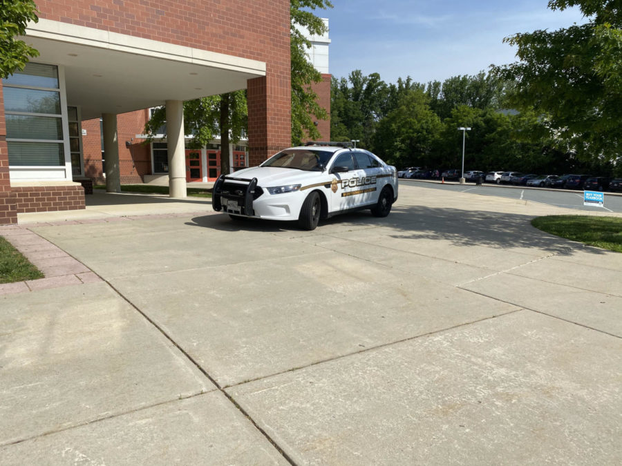 Last year, the RHS school resource officer parks in front of the school building as students enter. This year, schools opened without SROs as previously known.